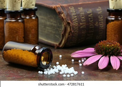 homeopathic echinacea pills on wooden background
