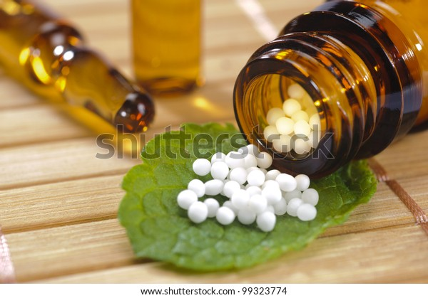 homeopathic globules on leaf