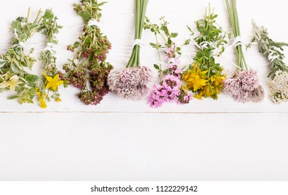 Homeopathy. A homeopathy concept with homeopathic medicine. Dried healing herbs St John's, oregano, thyme, yarrow . Overhead top view, flat lay. Copy space.