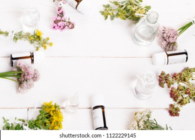 Homeopathy. A homeopathy concept with homeopathic medicine. Dried healing herbs St John's, oregano, thyme, yarrow wort and bottles of homeopathic globules. Overhead top view, flat lay. Copy space.