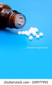 homeopathy pills in a blue background