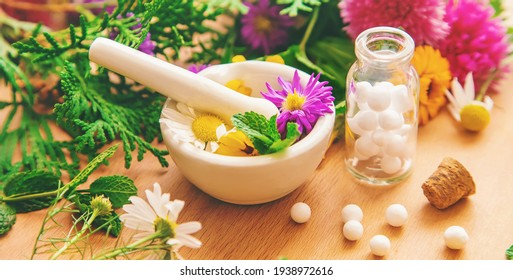 Homeopathy in small jars. Herbal extract. Selective focus. nature.