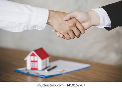 homeowner is happy after receiving the transfer of the right to occupy the home. Agent and client shaking hands after signed document and done business deal for transfer right of property.
