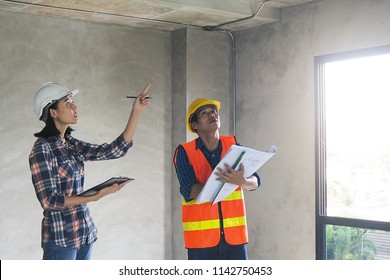 The homeowner is pointing out a correction to the head of the civil engineer team to fix it. Home inspection Concept