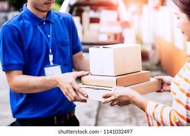 Homeowner woman receiving package from delivery man.
