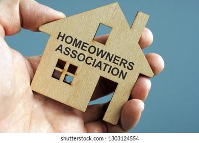 Homeowners Association HOA written on a model of home.