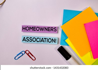 Homeowners Association! on sticky notes isolated on white background.