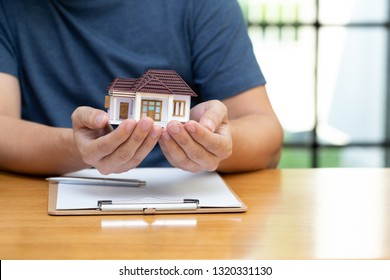 Homeowners selected refinancing of house and checking interest rates and monthly payments. Home mortgage loans from bank concept