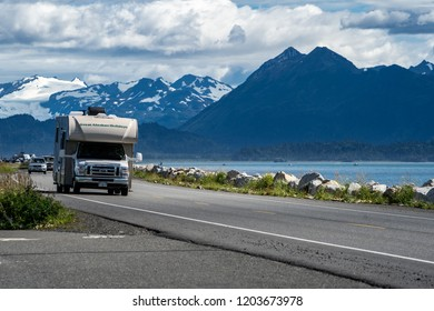 HOMER, ALASKA - AUGUST 3, 2018: RV recreational vehicle drives down the Homer Spit. This is a popular spot in the summer for camping