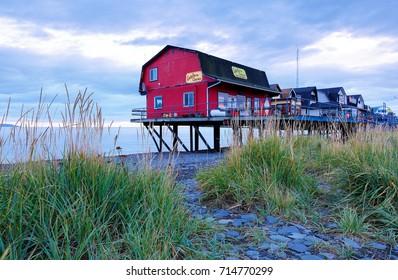 Homer, Alaska USA - August 31, 2017: Small red shop at Homer Spit Alaska before sunrise. Homer is a small city on Kachemak Bay, on Alaska's Kenai Peninsula. Homer Spit is a long strip of land.