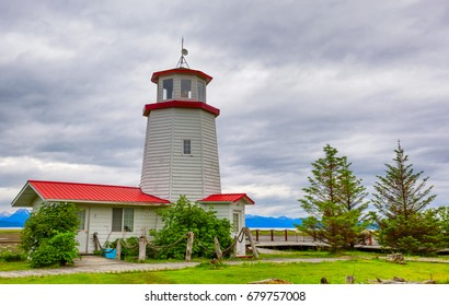 Homer, Alaska, USA - June 28, 2017:   Homer Lighthouse sits on the edge of Kachemak Bay under cloudy skies in Homer, Alaska.