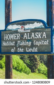 Homer, Alaska-June 17th, 2018: Sign for the city of Homer in Alaska proclaims it the halibut fishing capital of the world. Visitors come to Homer to fish the Cook Inlet and Kachemak Bay.