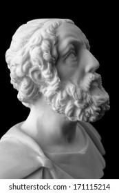 "Homer is the author of the poems, Iliad and Odyssey known as ""Homeric Epics"".  White marble bust of the greek poet."