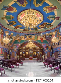 HOMER GLEN, ILLINOIS, USA - APRIL 18, 2019: Altar and sanctuary from the nave of the colorful Annunciation Byzantine Catholic Church in Homer Glen