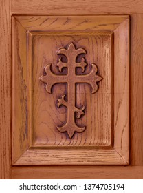 HOMER GLEN, ILLINOIS, USA - APRIL 18, 2019: Closeup of cross etched into wooden panel of door of the Annunciation Byzantine Catholic Church in Homer Glen