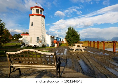 Homer Spit Lighthouse at sunset. Homer is a town on the north side of the entrance to Kachemak Bay from Cook Inlet, south of Anchorage, Alaska, USA.