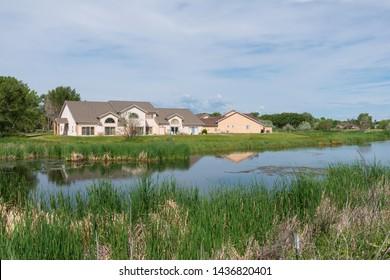 Homes along open space wetlands, Alamosa, Colorado