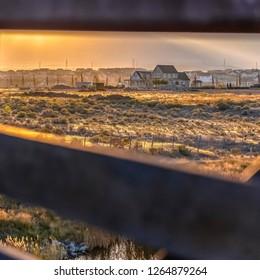 Homes in Daybreak Utah seen from bridge at sunset