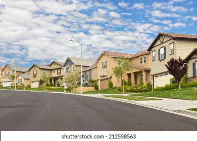 Homes in the suburbs are built on a hill.