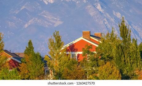 Homes and trees against mountain in Daybreak Utah
