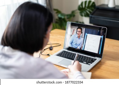 Homeschool Caucasian cute young girl student learning virtual internet online class from school teacher by remote meeting due to covid pandemic. Male teacher teaching math calculus by using whiteboard