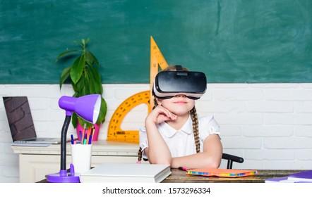 Homeschooling online. Girl kid study in virtual school. Virtual education. Child cute pupil wear hmd vr glasses. Virtual teaching. Studying in virtual reality. Modern technology. Interesting lesson.