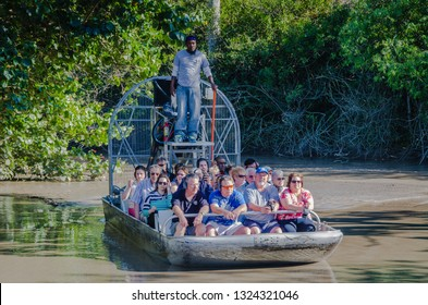 Homestead, FL / USA - 02-14-2015: Group of tourists on airboat ride at Everglades Alligator Farm in Southern Florida.
