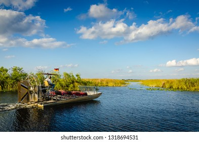 Homestead, FL / USA - 02-15-2014: Airboat hovers into path between grass on river in the Florida Everglades.