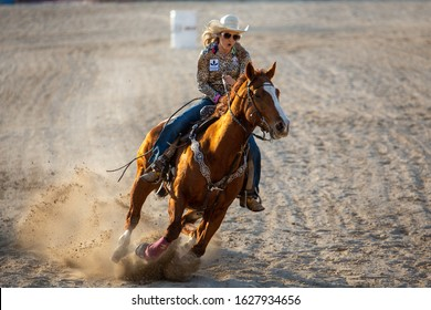 Homestead, Florida/USA - January 26, 2020: 71st Annual Homestead Championship Rodeo, unique western sporting event. Bull riding competition at Homestead Rodeo. Women's Barrel racing.
