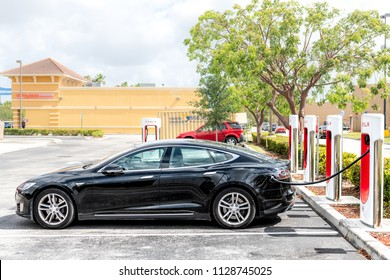 Homestead, USA - May 2, 2018: Closeup of Tesla Super Charging electric station in shopping mall with nobody, car parked at parking lot