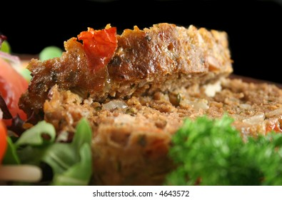 Homestyle lamb meatloaf with vegetables and salad.