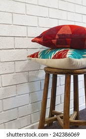 Homewares decorator cushions on a rustic wooden stool