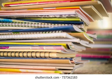 The homework book is a lot of students, the background is a beautiful bokeh.