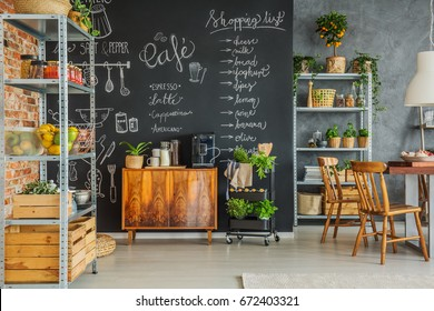 Homey kitchen with chalkboard wall in the loft