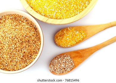 Hominy and wheat grits in wooden plates