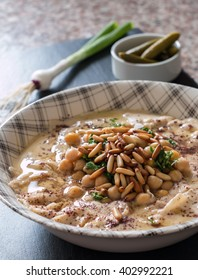 Hommos Fatteh with Pine Seeds