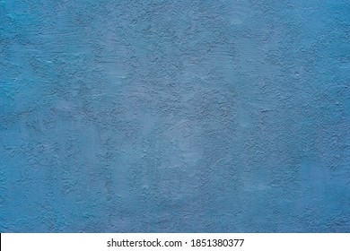 homogeneous coarse and rough texture plastered wall blue for background or wallpaper