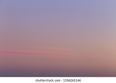 homogeneous sky of purple tone with pink stripes. incredible nature