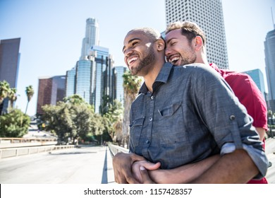Homosexual couple at a romantic date outdoors - Multi-ethnic gay couple in love flirting and having fun