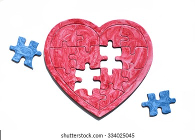 homosexual partner, concept. red heart puzzle with blue details symbolizes love homosexual couples, isolated on white background