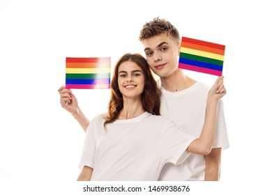 homosexual young couple in white t-shirts on an isolated background