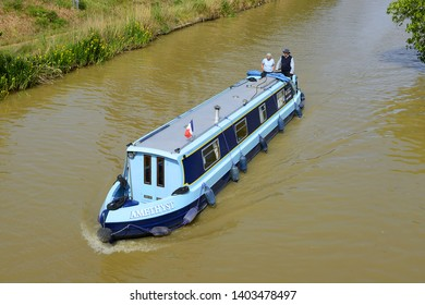 HOMPS, FRANCE - MAY 7, 2019: Canal du Midi near Homps. Homps is small village of Aude, on the banks of the Canal du Midi - UNESCO World Heritage Site