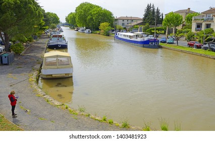 HOMPS, FRANCE - MAY 7, 2019: Harbor in Homps. Homps is small village of Aude, on the banks of the Canal du Midi - UNESCO World Heritage Site