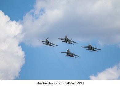 HOMS, Syria - July 20, 2019: Aviation Group of the Russian Aerospace Force in Syria. Bambandirocyc military fighters in the air against the blue sky.