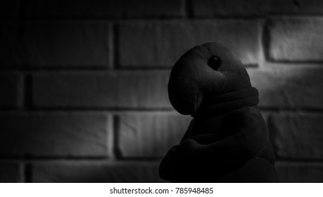 Homunculus loxodontus sits on a brick wall background