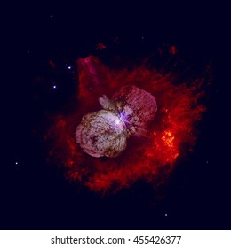 The Homunculus Nebula is a bipolar emission and reflection nebula surrounding the massive star system Eta Carinae. Retouched colored image. Elements of this image furnished by NASA.