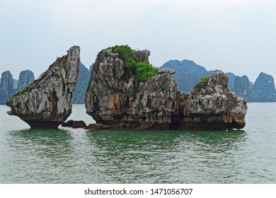 Hon Ga Choi Island (Cock and Hen Island) located in Halong bay, Vietnam. Another famous name is Trong Mai island (Cock and Hen Island)