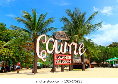 Honda bay, Philippines - September 27, 2018: Welcome sign installed at the Cowrie island on idyllic resort background. Popular tourist excursions from Honda Bay on the tropical islands near of Palawan