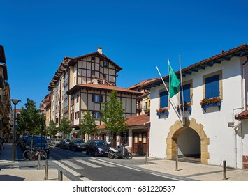Hondarribia, Spain - July 16, 2017. Typical antique buildings in Zuloaga Kalea street (city centre) of Hondarribia (Fuenterrabia), in Gipuzkoa, Basque Country, Spain.