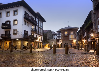 HONDARRIBIA-DECEMBER 20, 2014: Sunset in the village and after rain the light reflect on the cobblestones on Hondarribia, The Basque Countre on December 20, 2014. Spain